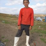 Protectoplast donated lots of distinctive white boots for the children on Pata Rat dump.