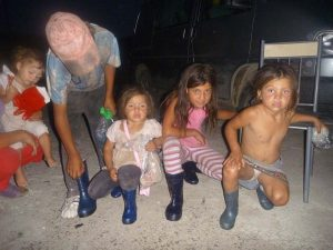 This family waited in the rain to receive their boots.