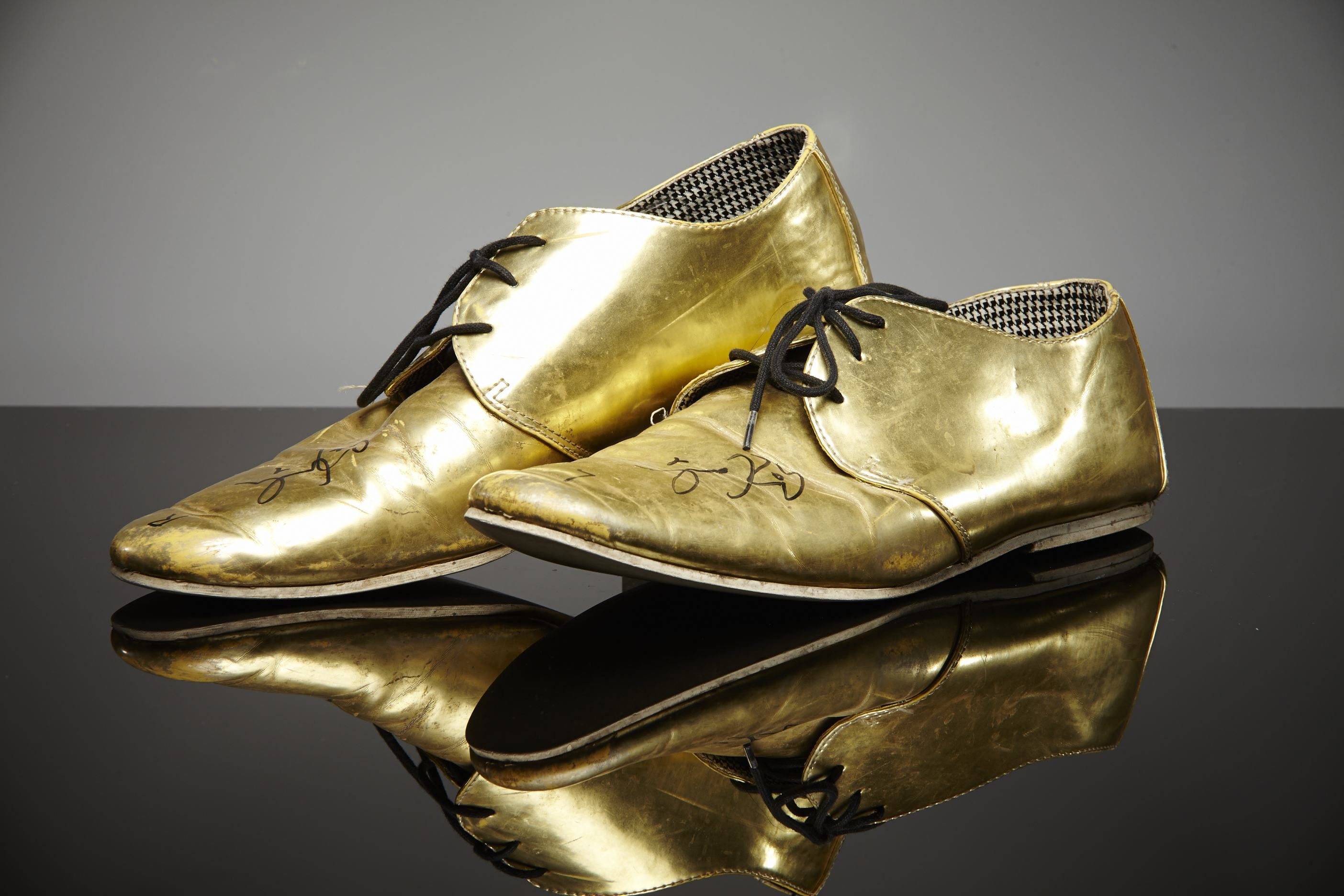 Coombes' bought his amazing gold loafers at the start of his 2010 tour with The Hotrats. They are a UK size 10.