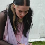 Kate signing her shoes at the festival