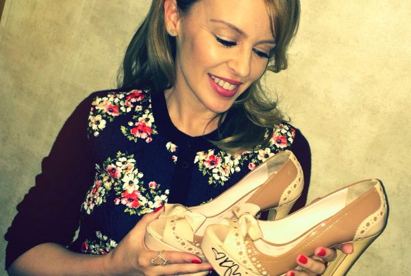 Kylie with her donated Miu Miu shoes